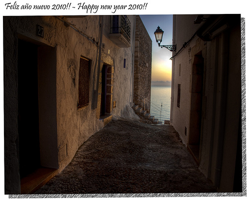 The dawn of the new year as seen through a narrow street of Peniscola, Spain