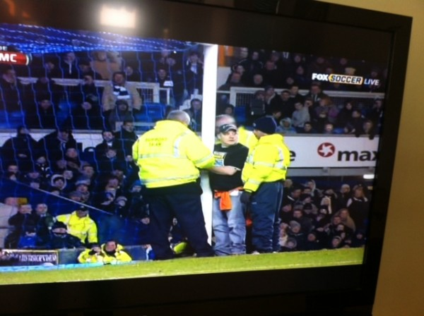 goodison park protester 1 600x448 Protester Handcuffs Himself to Goalpost During Everton Man City Match: Photos