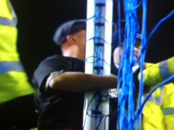 goodison park protester 2 600x448 Protester Handcuffs Himself to Goalpost During Everton Man City Match: Photos