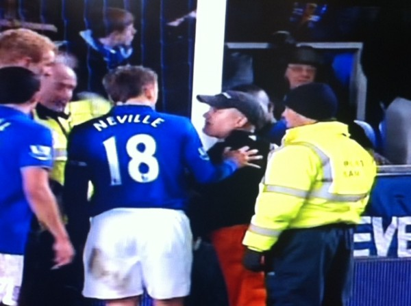 goodison park protester 5 600x448 Protester Handcuffs Himself to Goalpost During Everton Man City Match: Photos