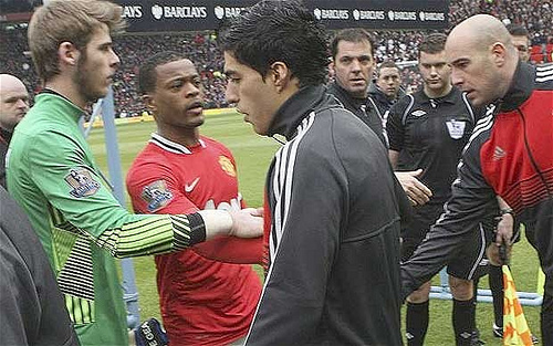 luis suarez handshake Why Luis Suarez Is A Villain Of The Game