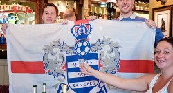 The crew don their QPR flag and shot glass!