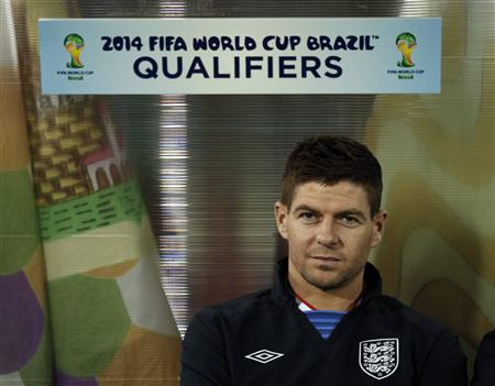 England's Steven Gerrard sits on the bench before their 2014 World Cup qualifying soccer match against San Marino in San Marino