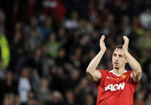 Manchester United's Neville applauds the crowd during his testimonial soccer match against Juventus in Manchester