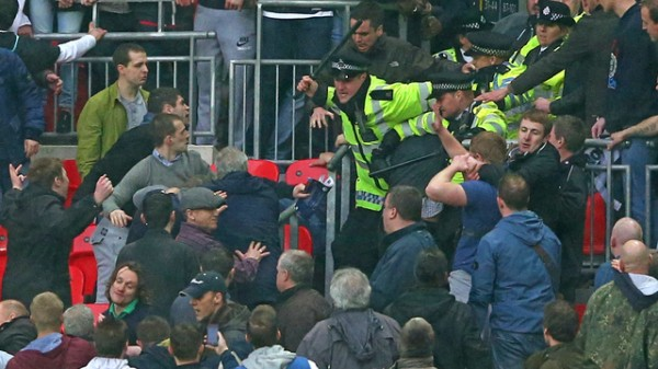 police push millwall back 600x337 Millwall Hooligans Clash With Fans and Police at Wembley FA Cup Semi Final [PHOTOS & VIDEO]