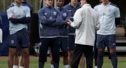 England manager Fabio Capello talks to his players during a team training session in London Colney
