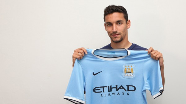 jesus navas man city shirt holding 600x337 Jesus Navas Signs For Manchester City: Its Official [PHOTOS]