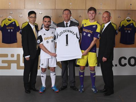 swansea city home away shirts Swansea City Officially Unveil New Home and Away Kits [PHOTOS]