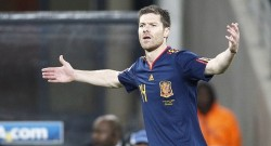 Spain's midfielder Xabi Alonso reacts du