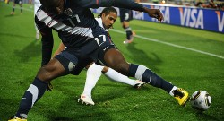 US striker Jozy Altidore (L) controls th
