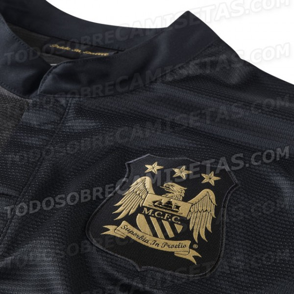 manchester city away shirt crest 600x600 Manchester City 2013 14 Away Shirt Leaked: Official [PHOTOS]