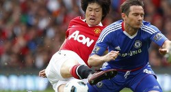 Manchester United's Ji-Sung Park challenges Chelsea's  Lampard during their English Premier League soccer match at Old Trafford in Manchester