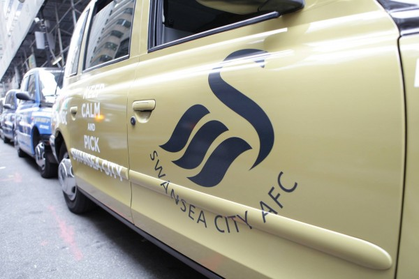swansea taxi cab 600x400 New Photos of London Taxi Cabs in Premier League Team Colors In New York City [PHOTOS]