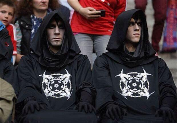 black robes What's the deal with the black hooded monks in robes at soccer games?