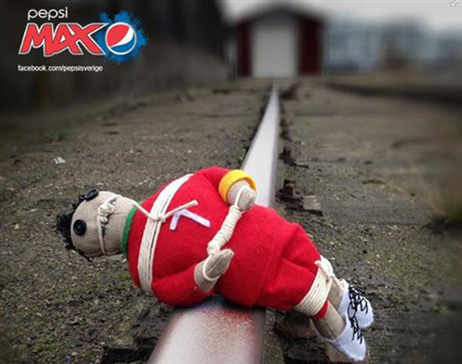cristiano ronaldo train tracks Cristiano Ronaldo Voodoo Doll Ad Campaign Backfires for Swedish Soft Drink Maker [PHOTOS]