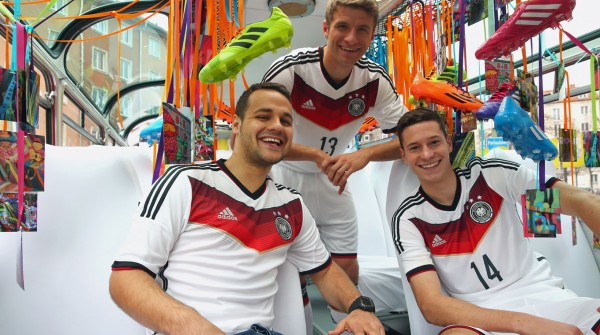 germany world cup shirt bus 600x335 Mesut Ozil and Julian Draxler Model Germanys World Cup 2014 Shirt: Official [PHOTOS]