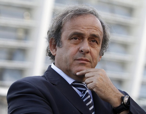 UEFA President Michel Platini are seen in front of a stadium in Kiev