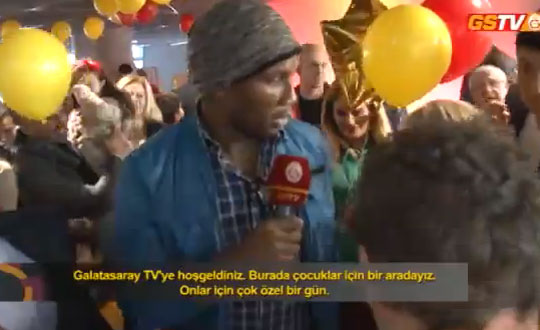 didier drogba Didier Drogba Becomes a Roving Reporter and Interviews Kids During Holiday Party [VIDEO]