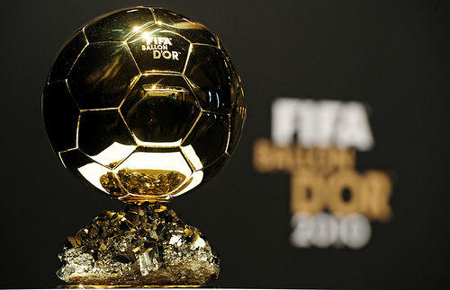 The FIFA Ballon d'Or trophy is displayed