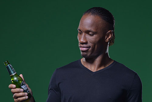 didier drogba beer commercial WATCH Didier Drogba Star In New Beer Ad As He Dribbles Around The World [VIDEO]
