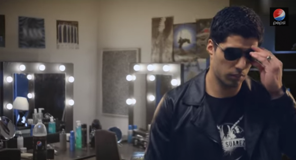 luis suarez 600x325 Liverpool Striker Luis Suarez Sings Born To Be Wild In New Soft Drink Ad [VIDEO]