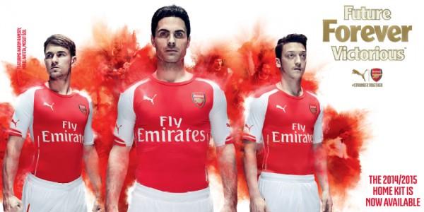 arsenal home shirt promo 600x300 WATCH Arsenal Unveil Home, Away and Third Shirts for 2014/15 Season [VIDEOS]