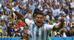 Argentina's Marcos Rojo celebrates after scoring a goal during the 2014 World Cup Group F soccer match against Nigeria at the Beira Rio stadium in Porto Alegre