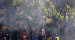 CSKA Moscow's supporters clash with stewards during Champions League Group E soccer match against AS Roma at the Olympic Stadium in Rome
