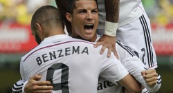 Real Madrid's Ronaldo celebrates with team mate Benzema after he scored against Villarreal during their Spanish first division soccer match at the Madrigal stadium in Villarreal