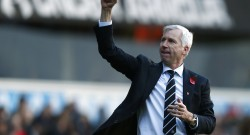 Newcastle United's Pardew celebrates after their English Premier League soccer match against Tottenham Hotspur in London
