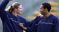 Thierry Henry (R) and French team mate Emmanuel Petit at Arsenal train in Lens April 19 before their..