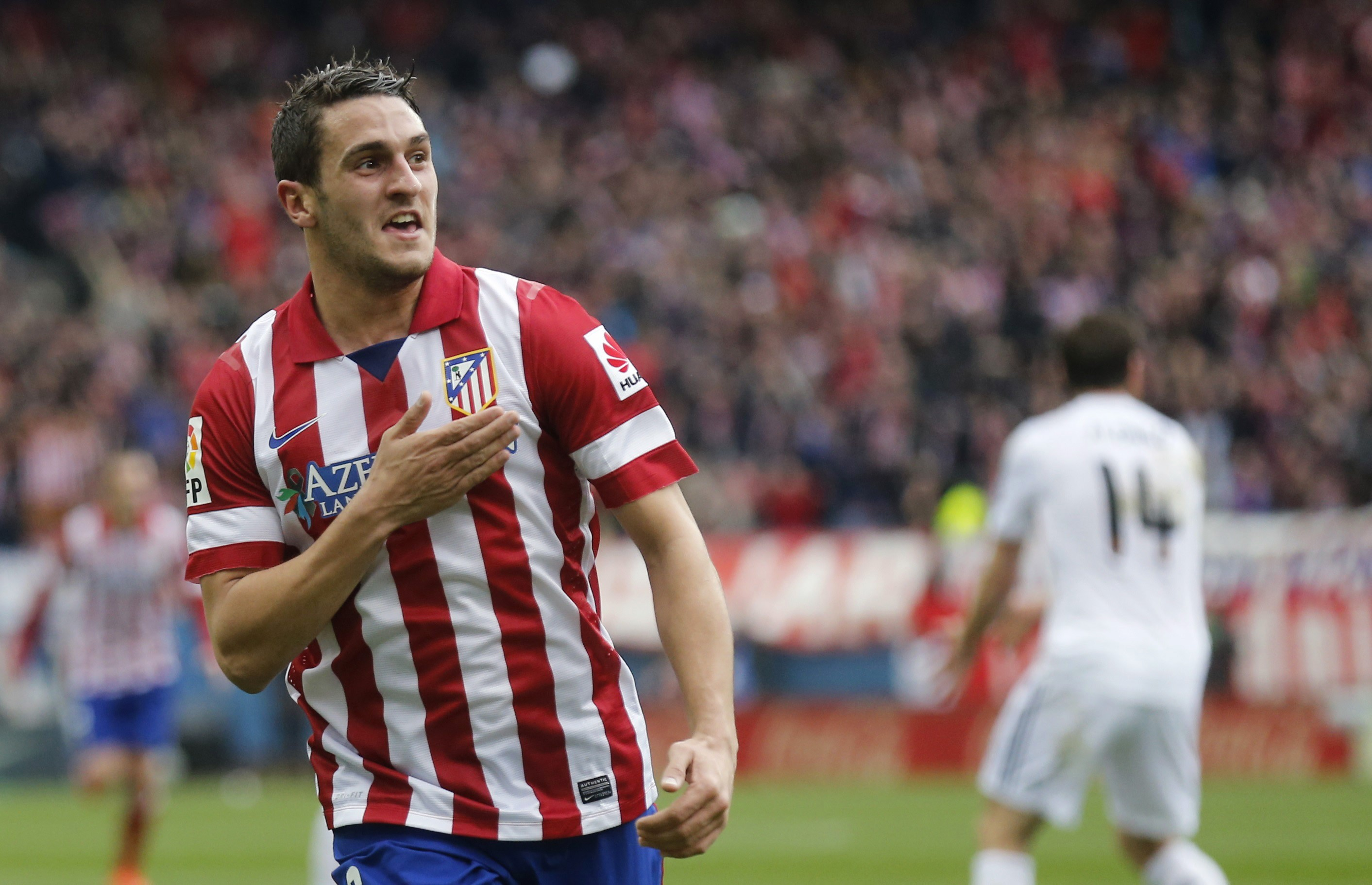 "Atletico Madrid's Jorge ""Koke"" Resurrecion celebrates his goal against Real Madrid during their Spanish first division soccer match in Madrid"