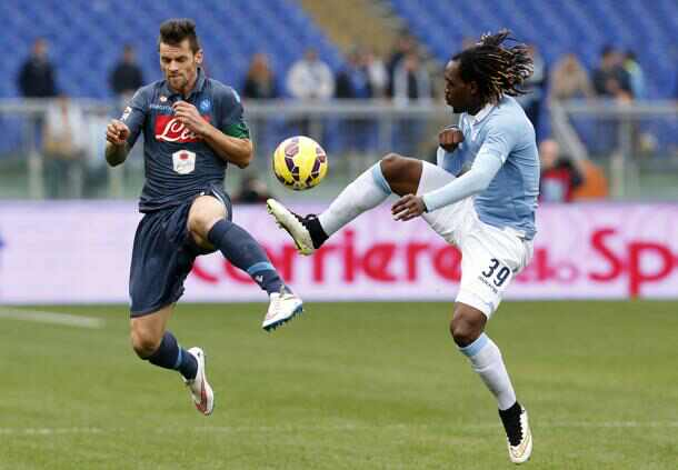 Napoli's Maggio and Lazio's Cavanda jumps for the ball during the Italian Serie A soccer match at the Olympic stadium in Rome